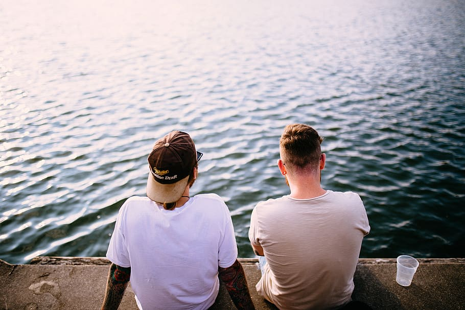 Two men on a dock discuss suicide prevention