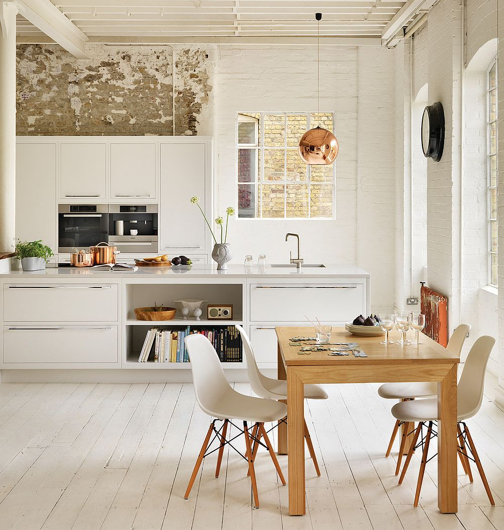 rustic white scandinavian kitchen with distressed brick wall, white wood floors, modern white cabinets, exposed ceilling and whitewashed brick walls