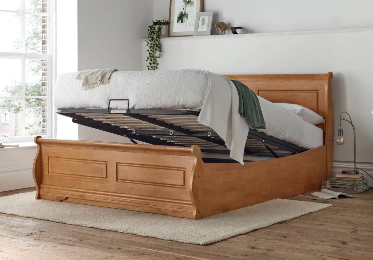 A large ottoman bed bed in a room