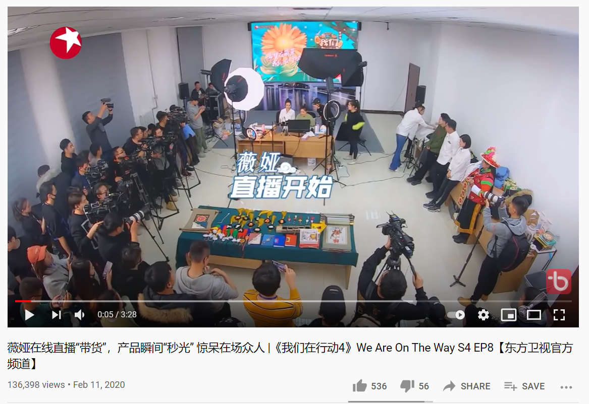Livestreaming ecommerce expert Viya does a livestream in a studio surrounded by photographers and staff. Studio view.
