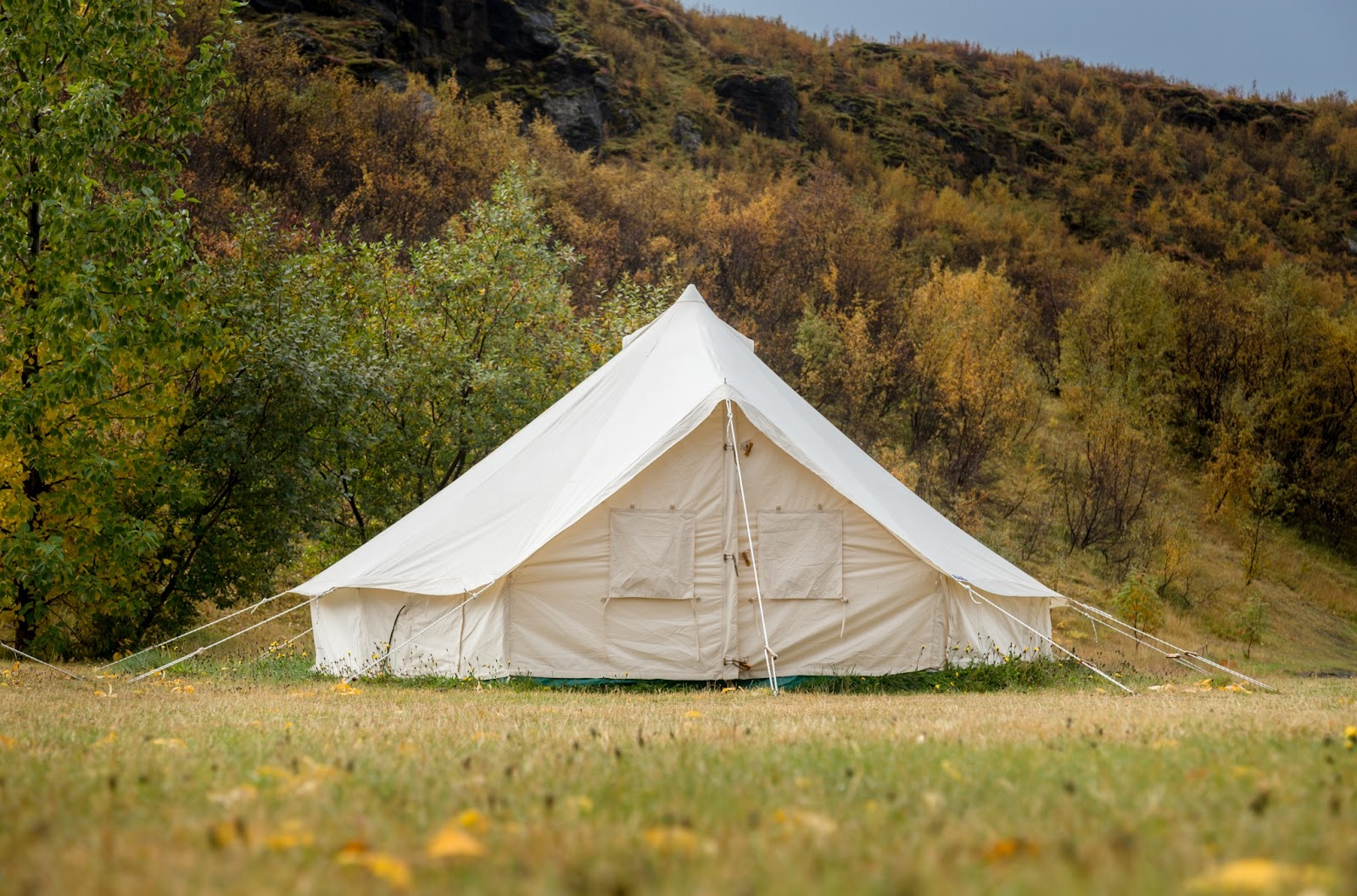 Glamping tent surrounded by autumn colors