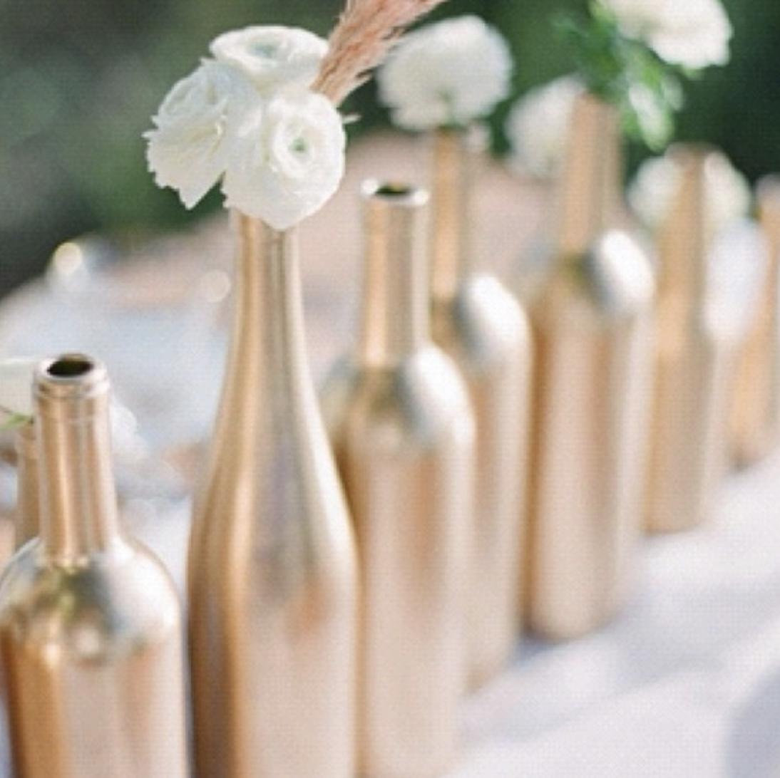 DIY wedding table arrangement painted wine bottles
