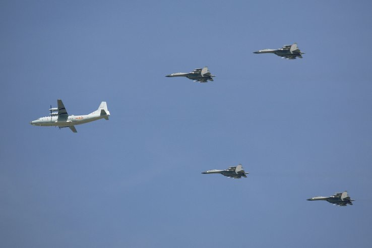 A Y-9 transport and J-15 carrier-borne fighter aircraft. (AP/PA)