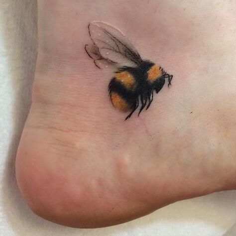 bee tattoo on foot