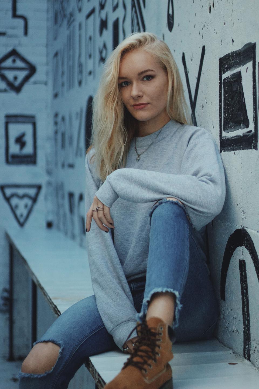 eople woman fashion model beauty blonde ripped jeans boots sweatshirt