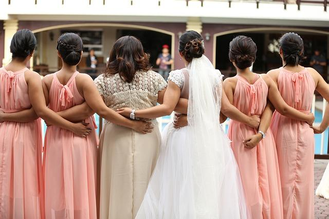 wedding ideas - bridesmaids and bride standing with their backs to the camera - wedding planning - services provided by wedding planners in Philadelphia PA - wedding planners capable - wedding ideas blog by K'Mich