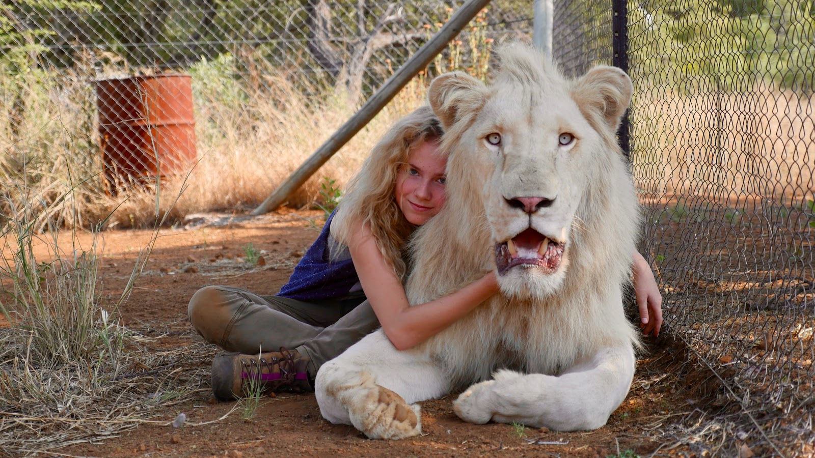 Movie still showing actress Daniah De Villiers with her white lion.