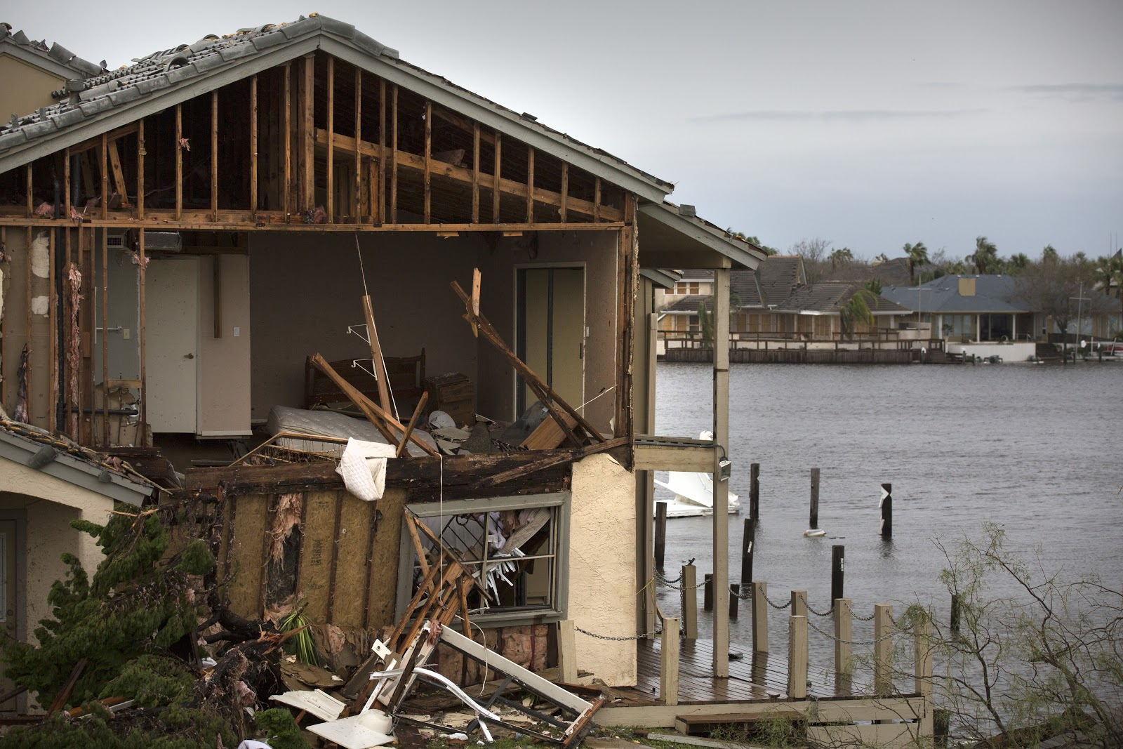 the shell of a house that has been destroyed by flooding