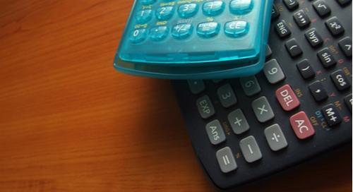 Calculators on a wood  table