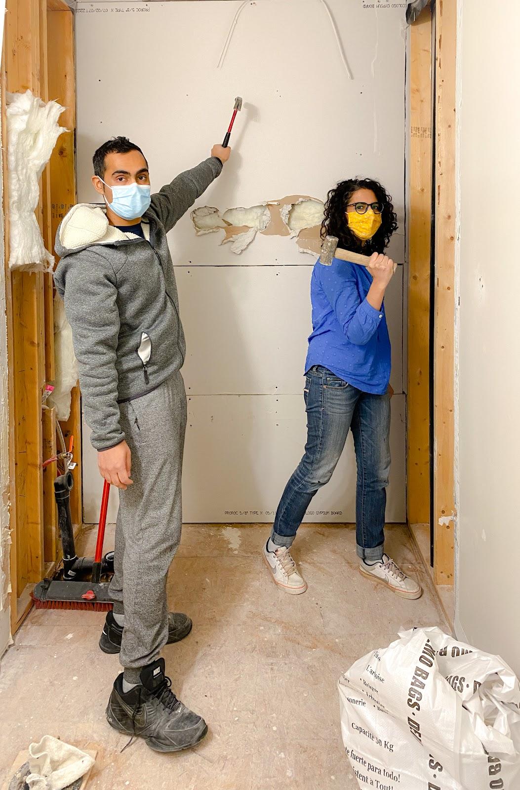 Smashing wall tiles for bathroom demolition