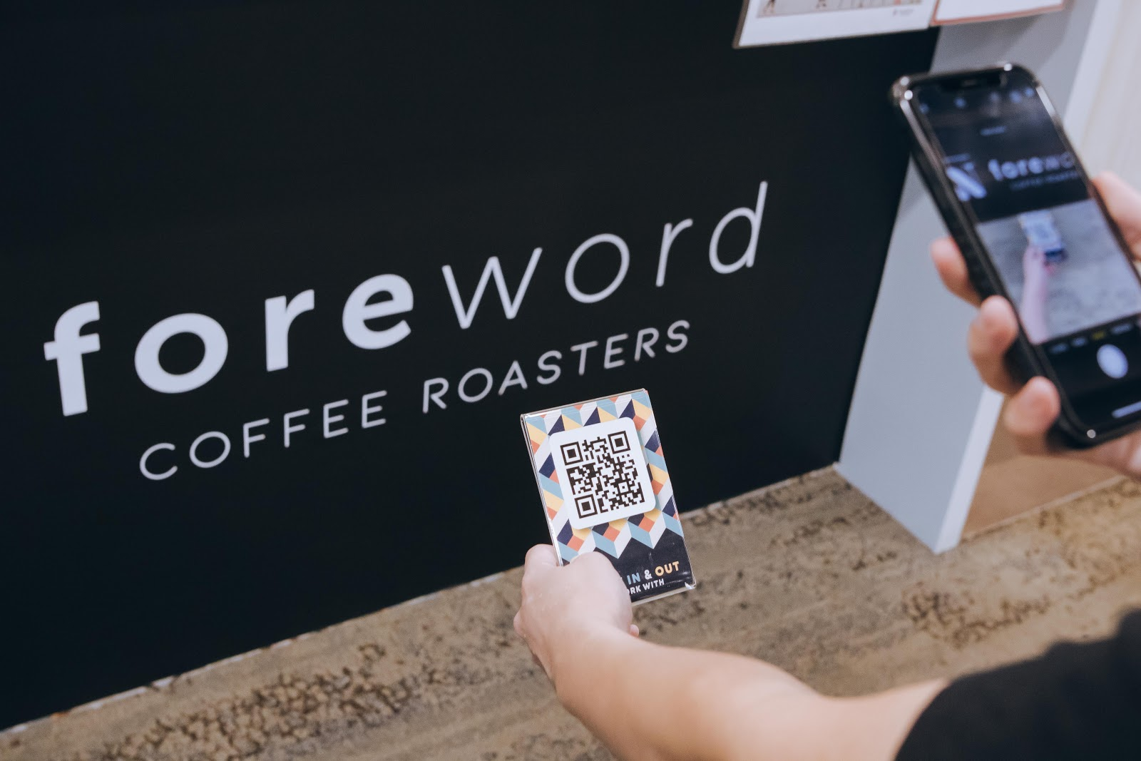 Employee at Foreword Coffee Roasters checking in with StaffAny