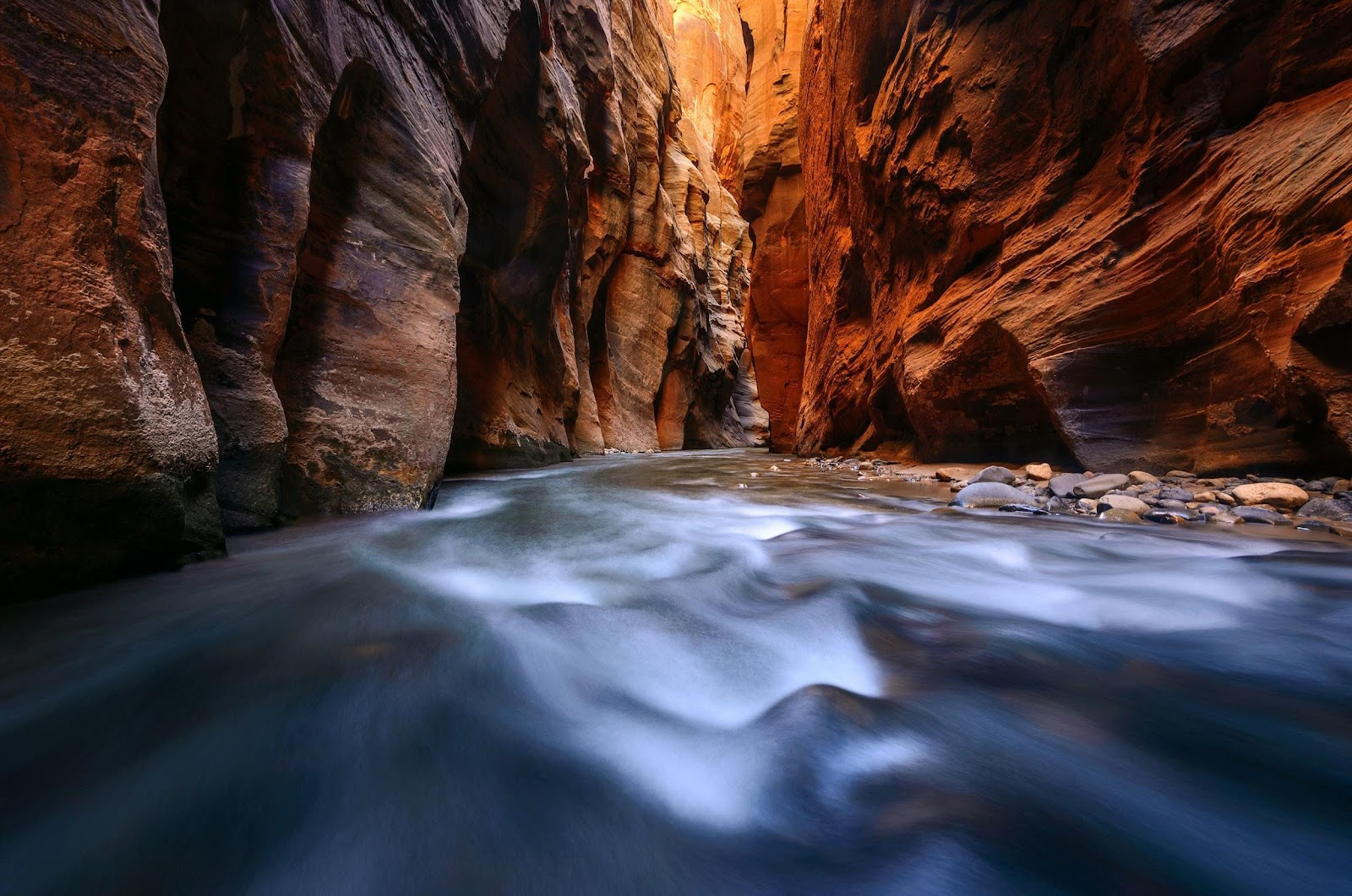 Flowing water inside The Narrows at Zion National Park.