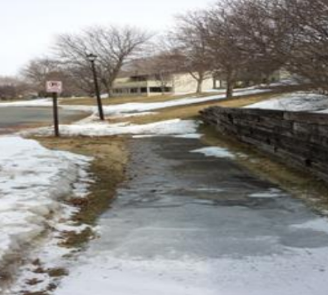 Icy sidewalk and failing retaining wall