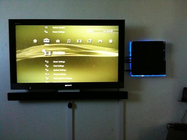 PS3 mounted on wall with backlight