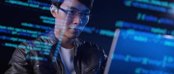 Asian man computer engineer programmer typing code hacking using computer with futuristic computer code, internet digital technology concept. Asian man computer engineer programmer typing code hacking using computer with futuristic computer code, internet digital technology concept. cybersecurity stock pictures, royalty-free photos & images