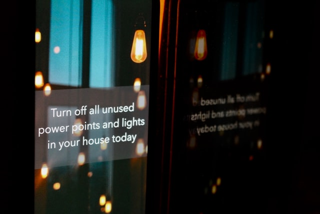 """Text for earth hour on a screen reading """"Turn off all unused power points and lights in your house today"""""""