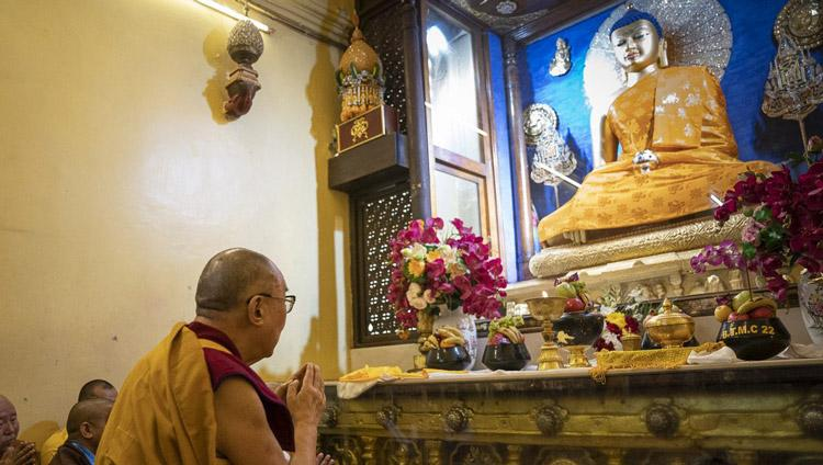 His Holiness the Dalai Lama paying his respects before the statue of the Buddha inside the stupa at the Mahabodhi Temple in Bodhgaya, Bihar, India on January 17, 2020. Photo by Tenzin Choejor