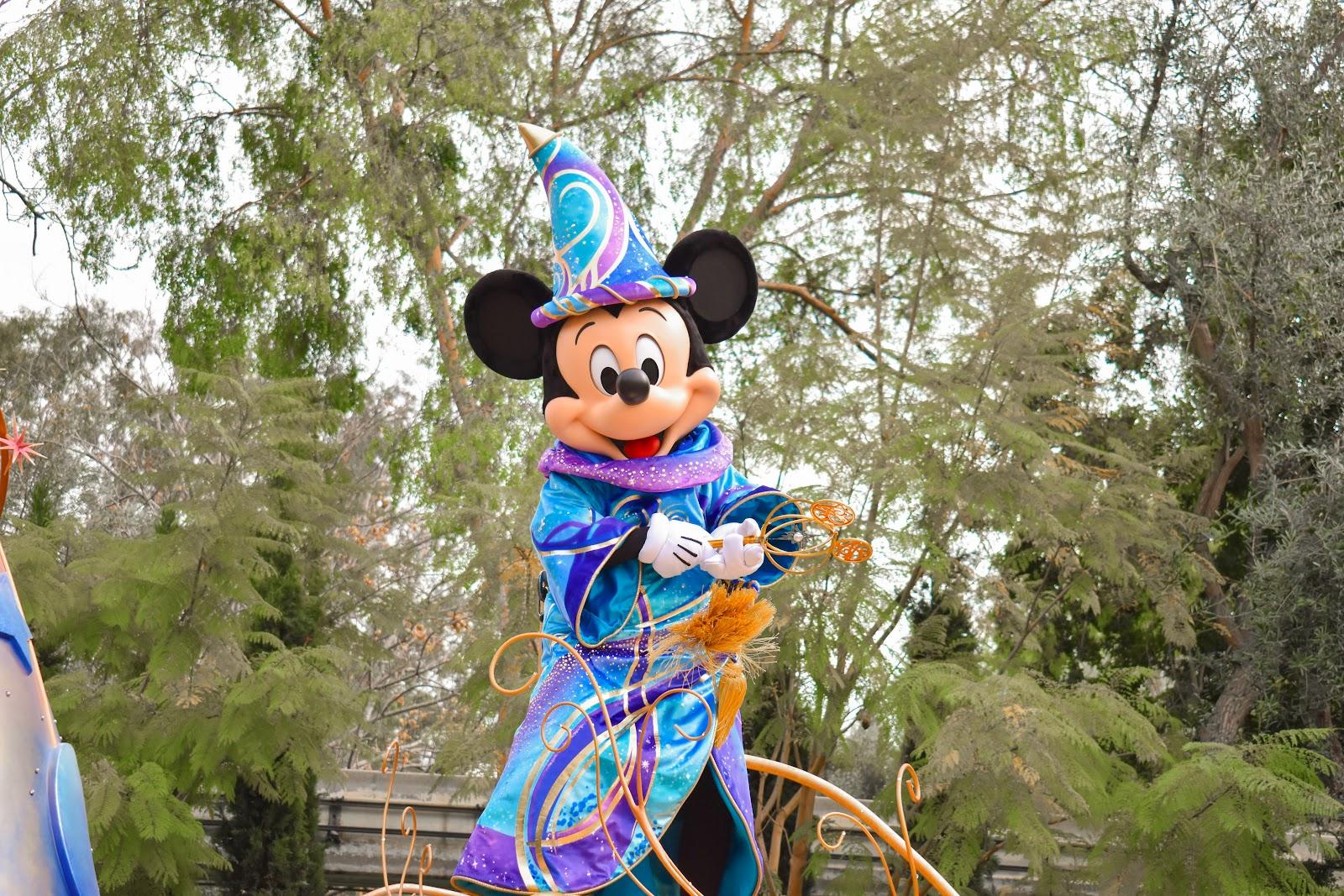 mickey in the magic happens parade at Disneyland