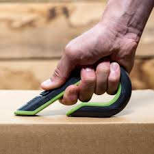 Picture of a safe way to open boxes using a safety tool.