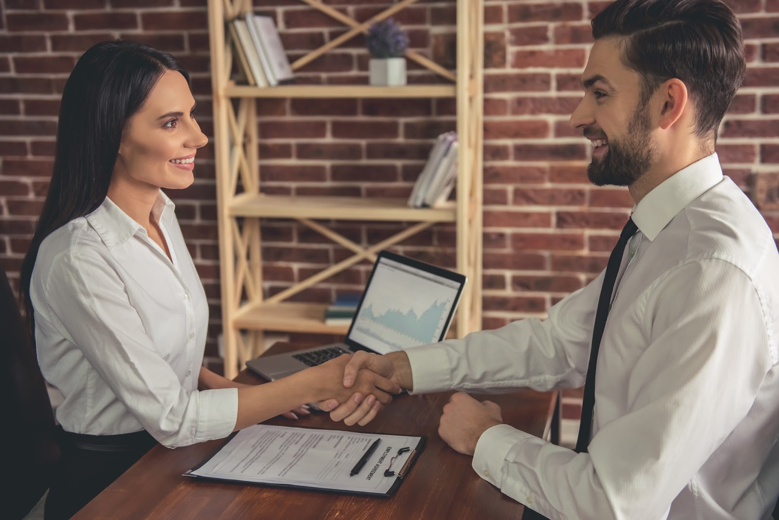woman manager shaking hands in interview