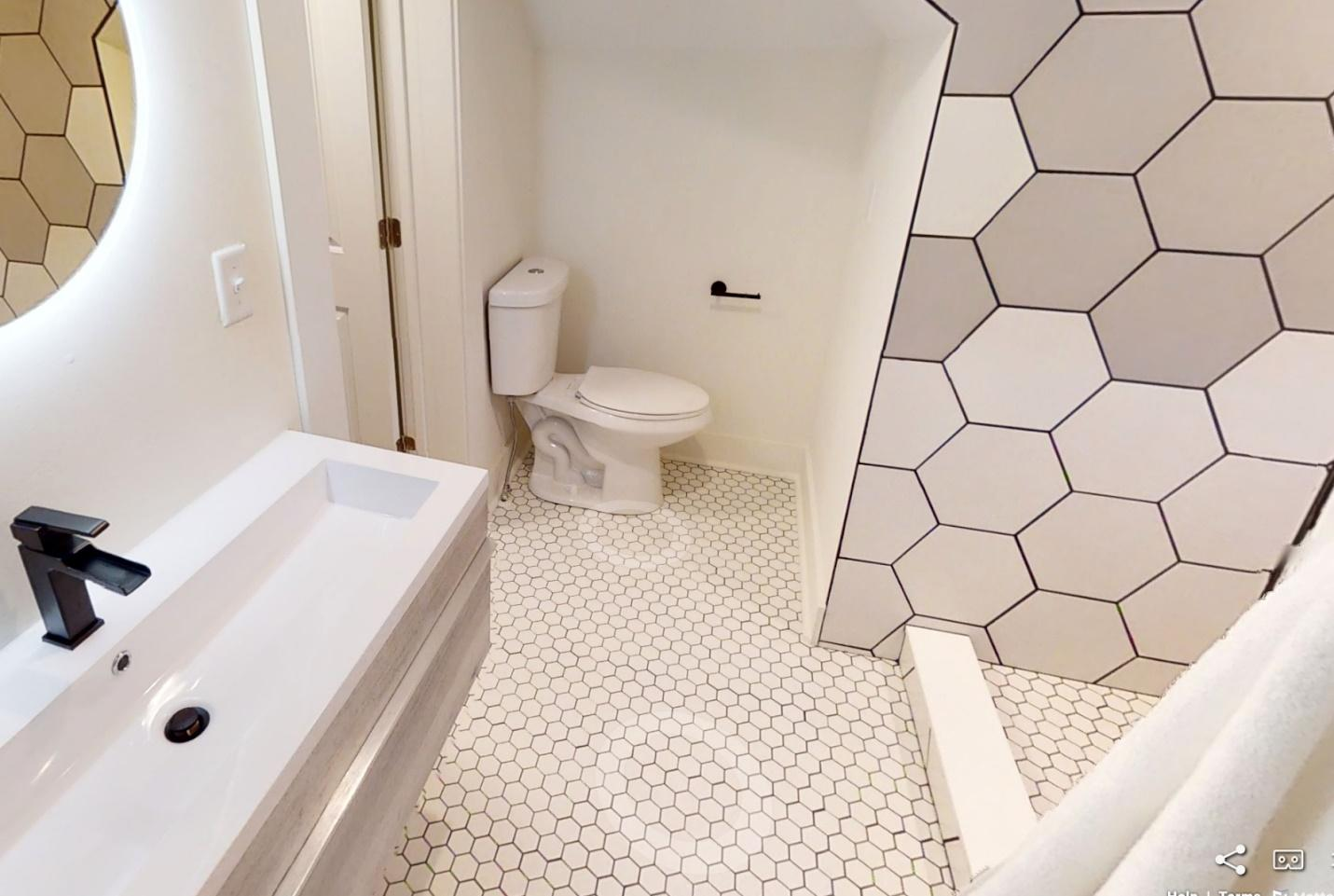 bathroom with toilet and tub