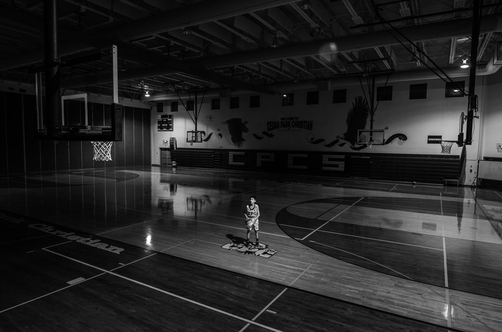 young boy playing basket ball one idea for improving your sports business