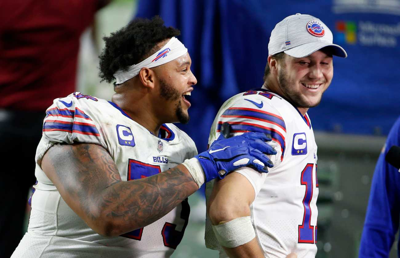 GLENDALE, ARIZONA - DECEMBER 07: Offensive lineman Dion Dawkins #73 of the Buffalo Bills jokes with quarterback Josh Allen #17 of the Bills following the NFL football game against the San Francisco 49ers at State Farm Stadium on December 07, 2020 in Glendale, Arizona. (Photo by Ralph Freso/Getty Images)