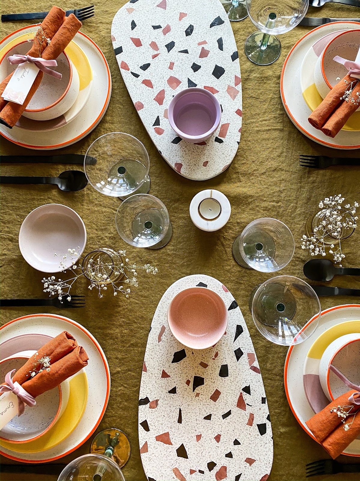 colourful tablescape with terrazzo serving platters