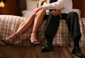 adultery-factors-man-touching-woman-leg