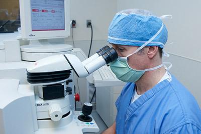 Doctor performing laser eye surgery