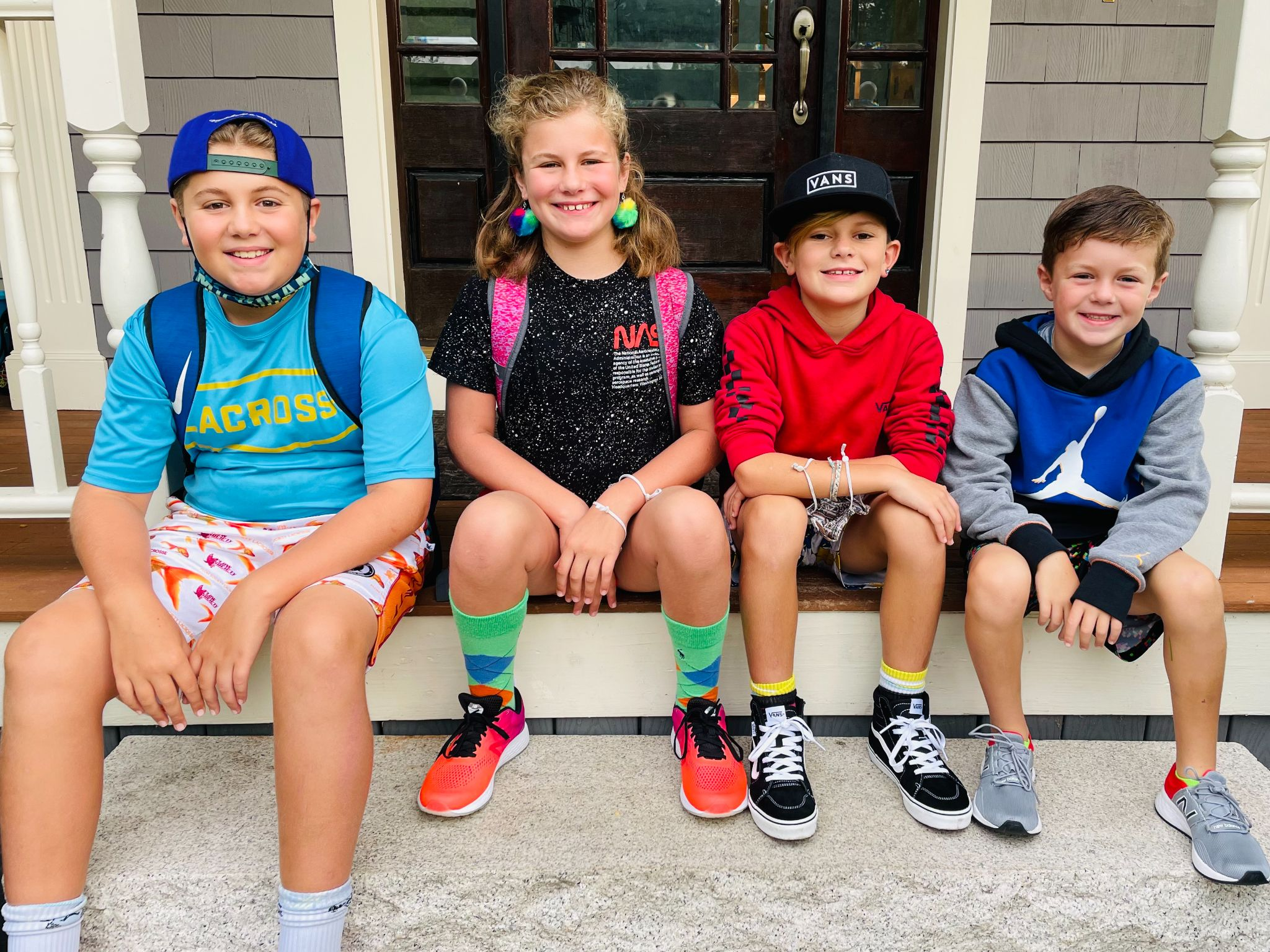Picture of Katie Novak's 4 kids on their first day of school