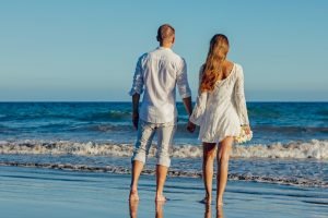 A couple on the beach. One of the best Miami locations for a romantic wedding is by the ocean.