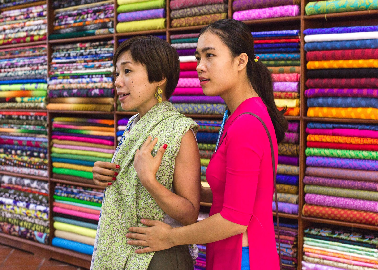 Checking fabric with a staff at Bebe: Tailor in Hoi An.