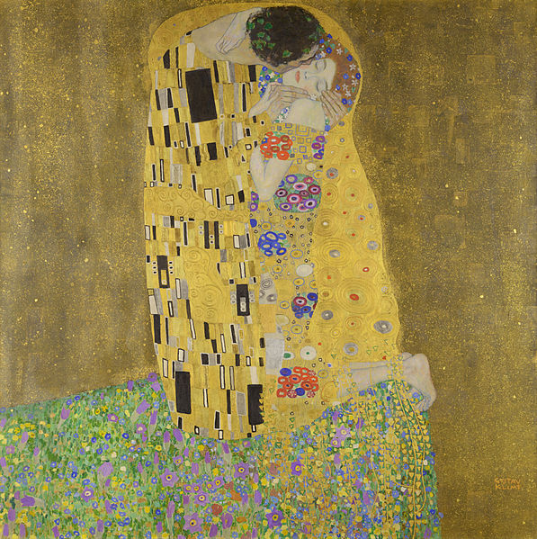 """Klimt's """"The Kiss,"""" depicting an embracing man and woman wrapped in a patchwork yellow quilt, all painted in an evocative, deliberately unrealistic style."""