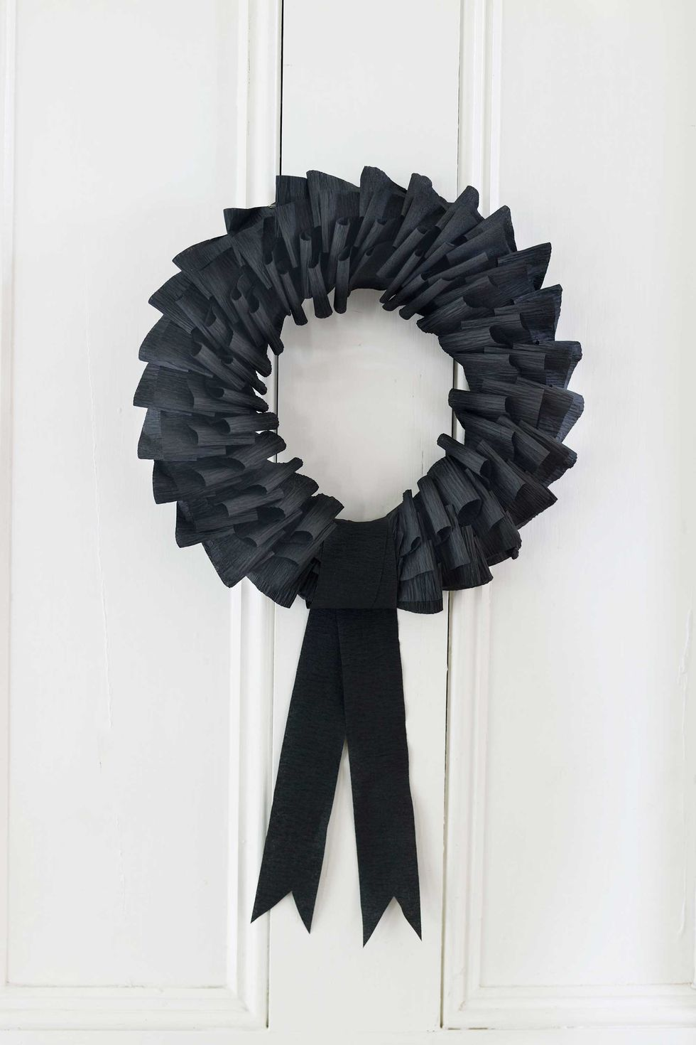 Black Wreath: These 30 DIY Halloween Decorations That Are Wickedly Creative will save you money and allow your creativity to flourish