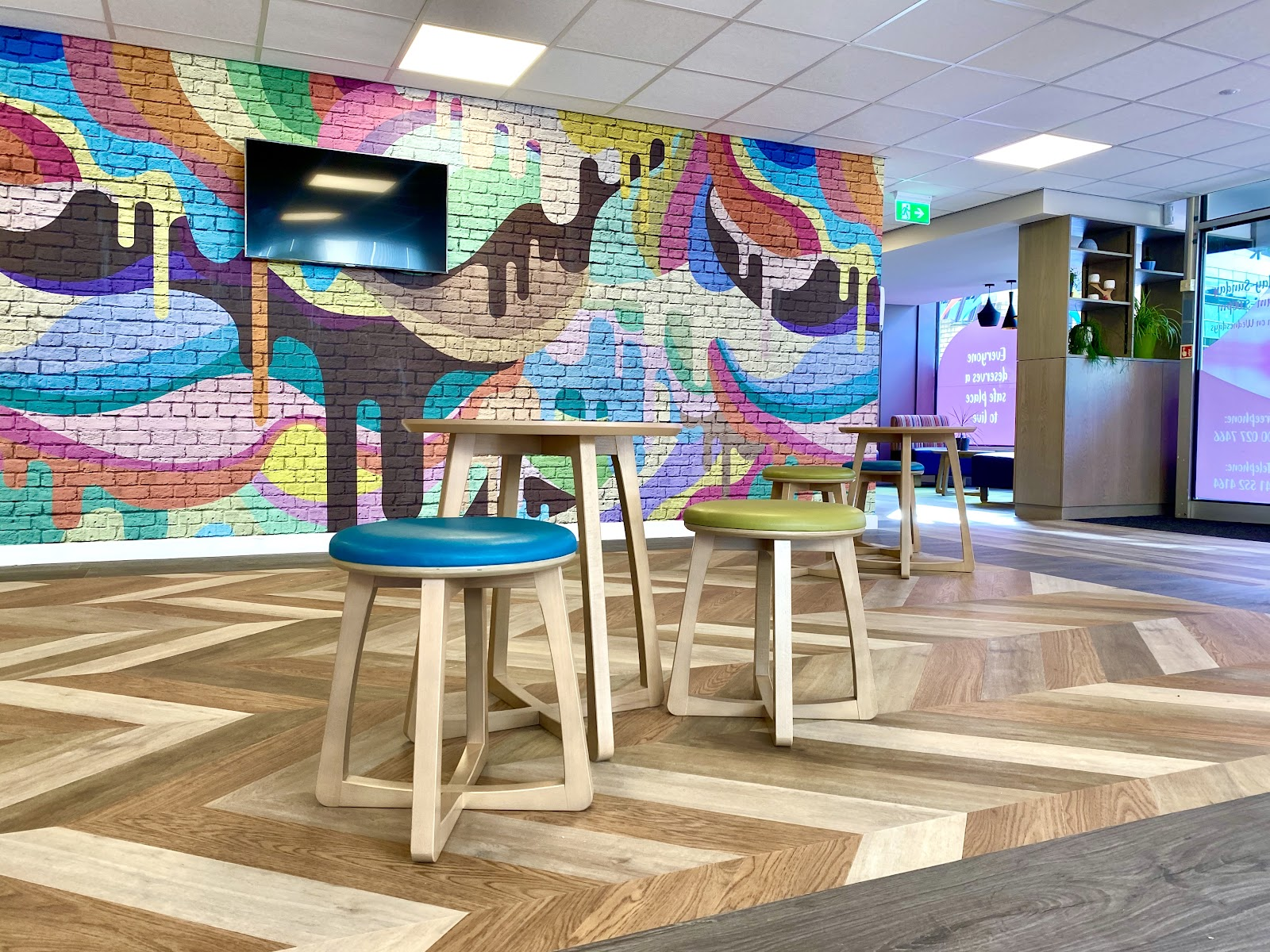 The new Access Hub with bright colours, beautiful wooden finishings and different zones for conversation and support.