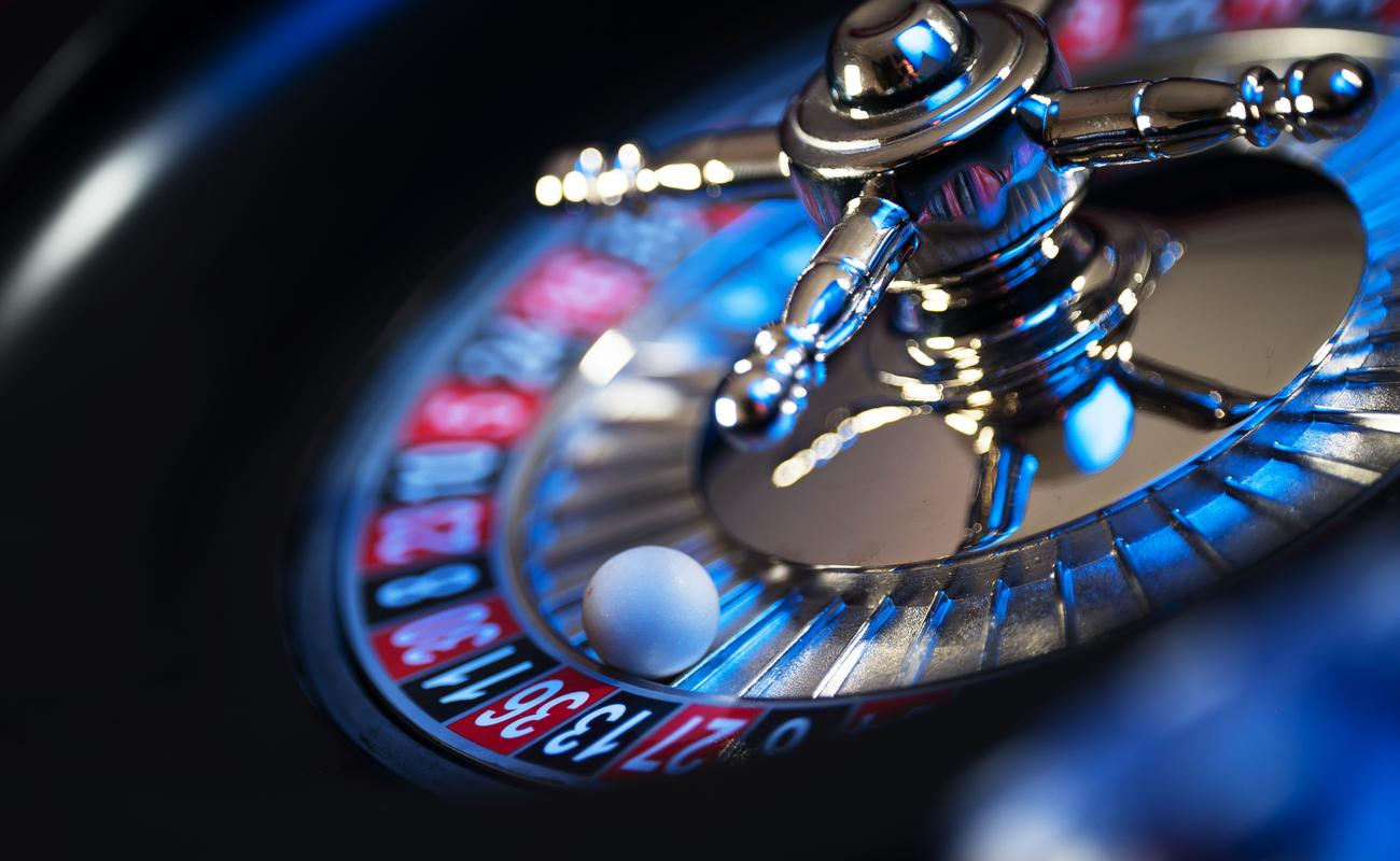 Roulette wheel with a white ball in it