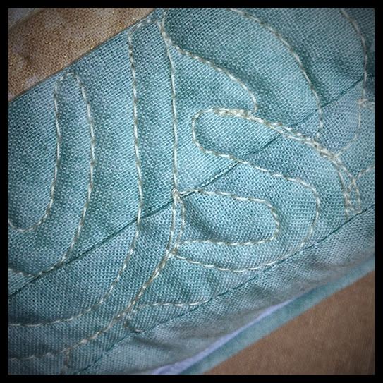 Quilted beach pillow waves