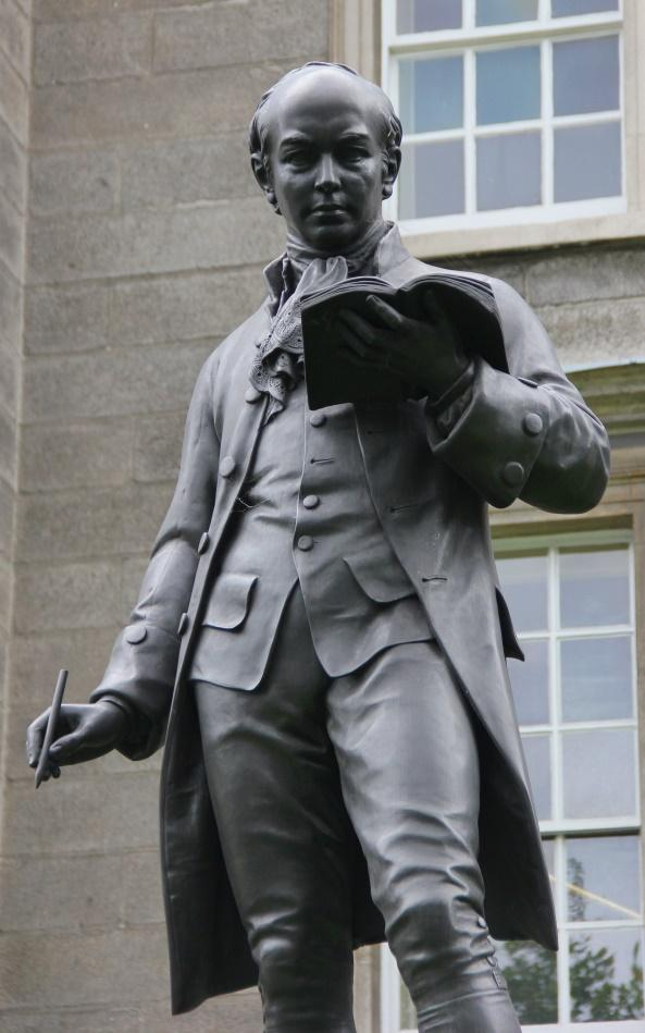 https://upload.wikimedia.org/wikipedia/commons/a/ae/Dublin_Trinity_College_Oliver_Goldsmith_Statue_02.JPG