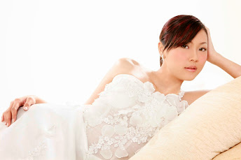 reclining bride in white