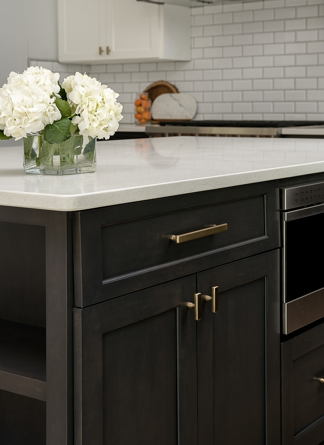 brown shaker kitchen cabinets with brass knobs and pulls
