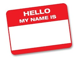 """[Image is a red name tag that says """"Hello my name is"""" with nothing written in the blank space.]"""