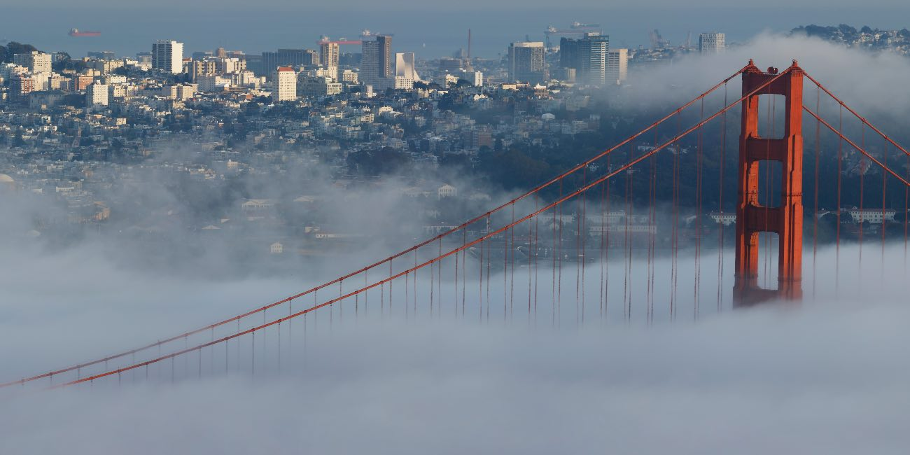 BERKELEY, CA - NOVEMBER 16: General view of the Golden Gate Bridge and downtown San Francisco skyline engulfed in fog which sets the scene prior to a college football game between the California Golden Bears and USC Trojans at California Memorial Stadium on November 16, 2019 in Berkeley, California. (Photo by Joe Robbins/Getty Images)