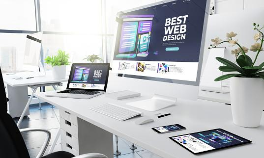 A picture containing text, indoor, desk, computer Description automatically generated