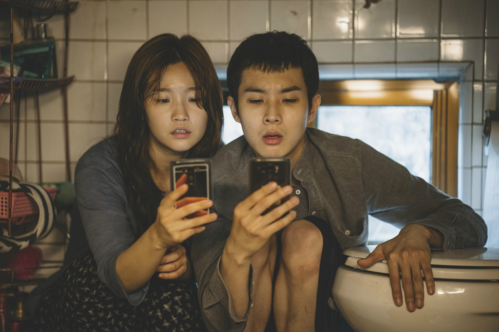 Park So Dam (left) and Choi Woo Shik as Sister and Brother Kim
