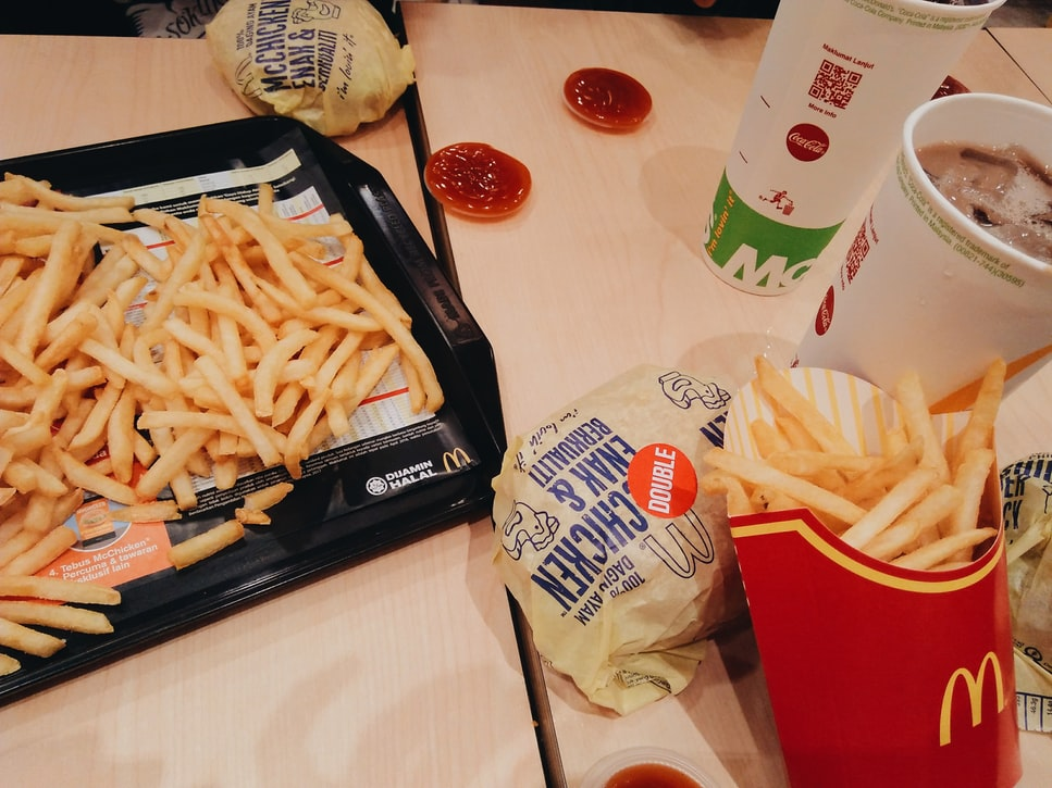 A McDonalds meal with food spread out on the table