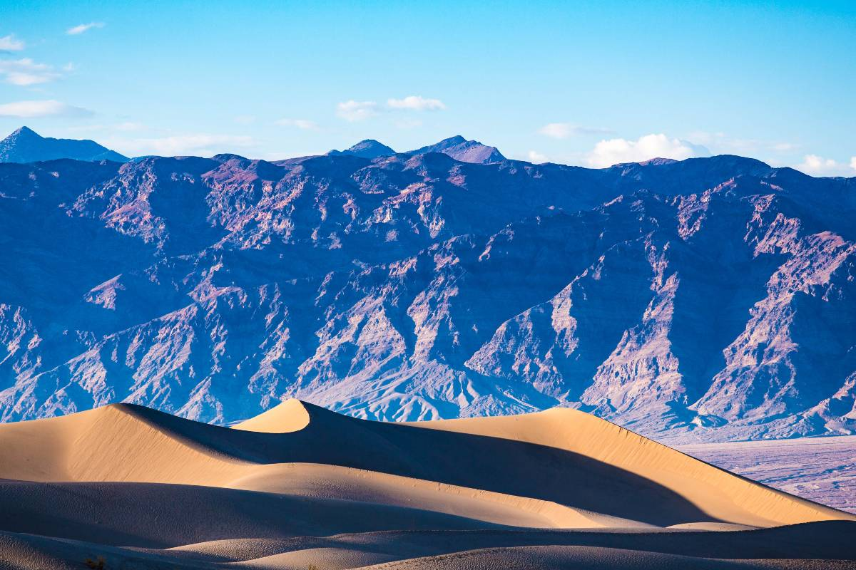 Sand dunes and mountains at Death Valley, one of the best national parks to visit in the winter
