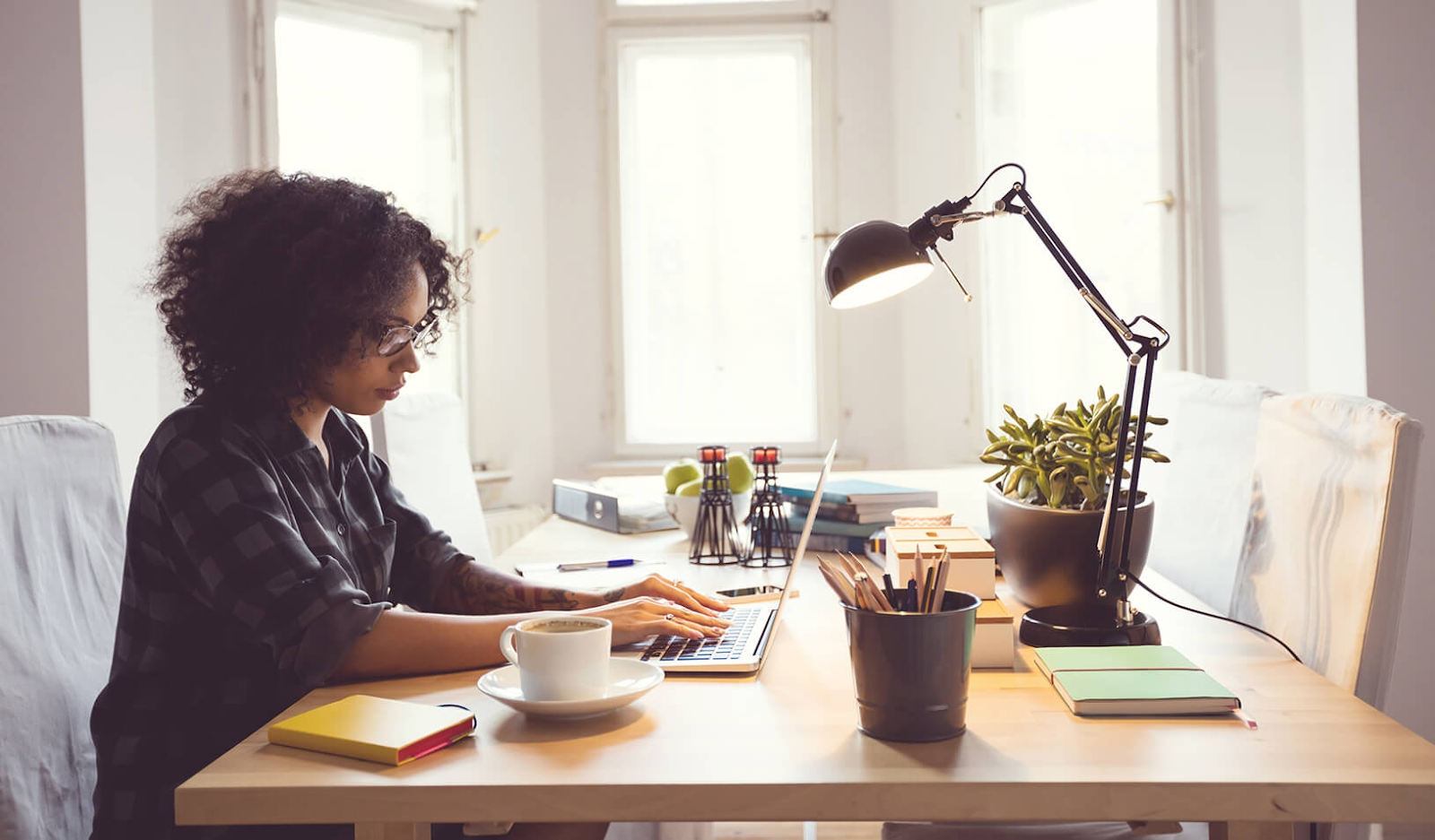 Money saving tips for university students - student managing finances and bills online