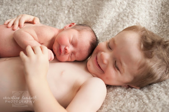 Newborn baby and big brother