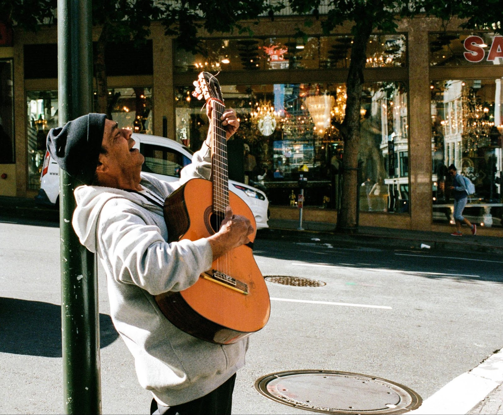 A busker with a guitar